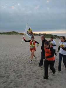 Ashley B about to cross the finish line at Reach The Beach 2011