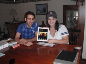 Matt, from Brinestone, helping Kristine set up her new iPad 2